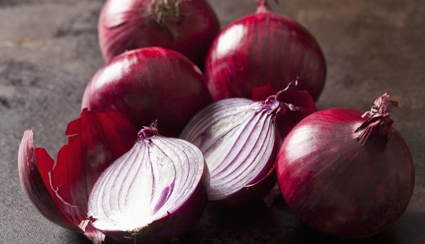 Whole and sliced red onions