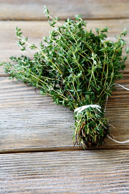 Bunch thyme on wooden boards